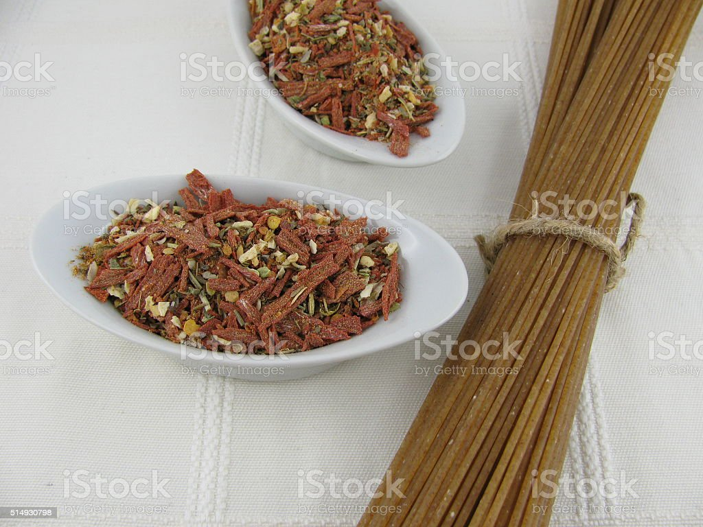 Spelt spaghetti with spice mix stock photo