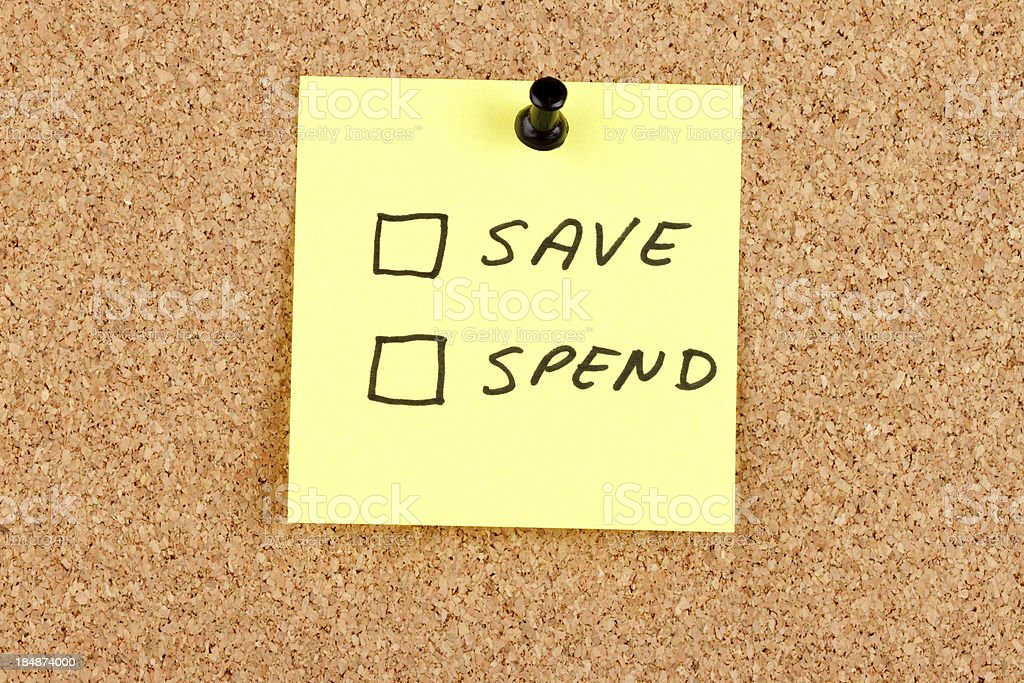 Spend and Save Checkboxes on an Adhesive Note royalty-free stock photo