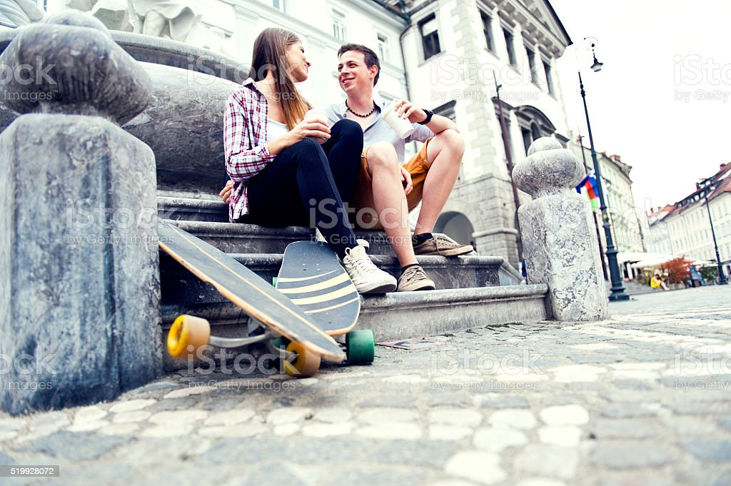 Spending a day with her skater boy stock photo