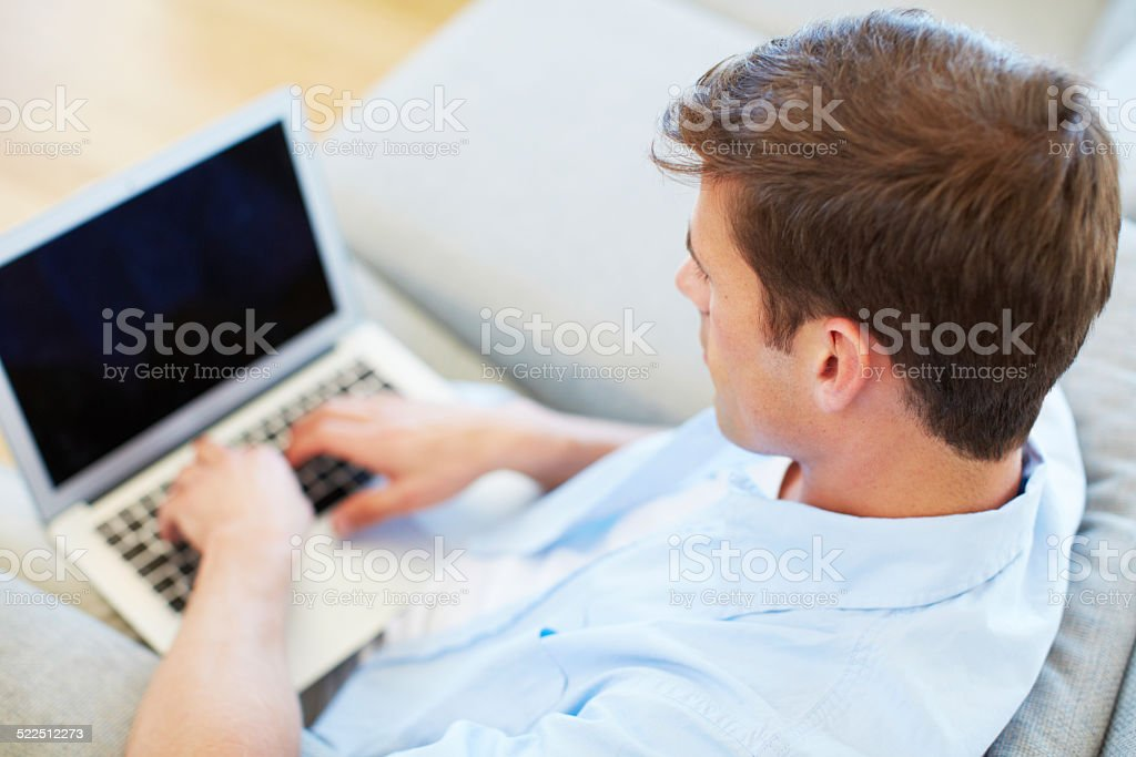 Spending his free time online stock photo