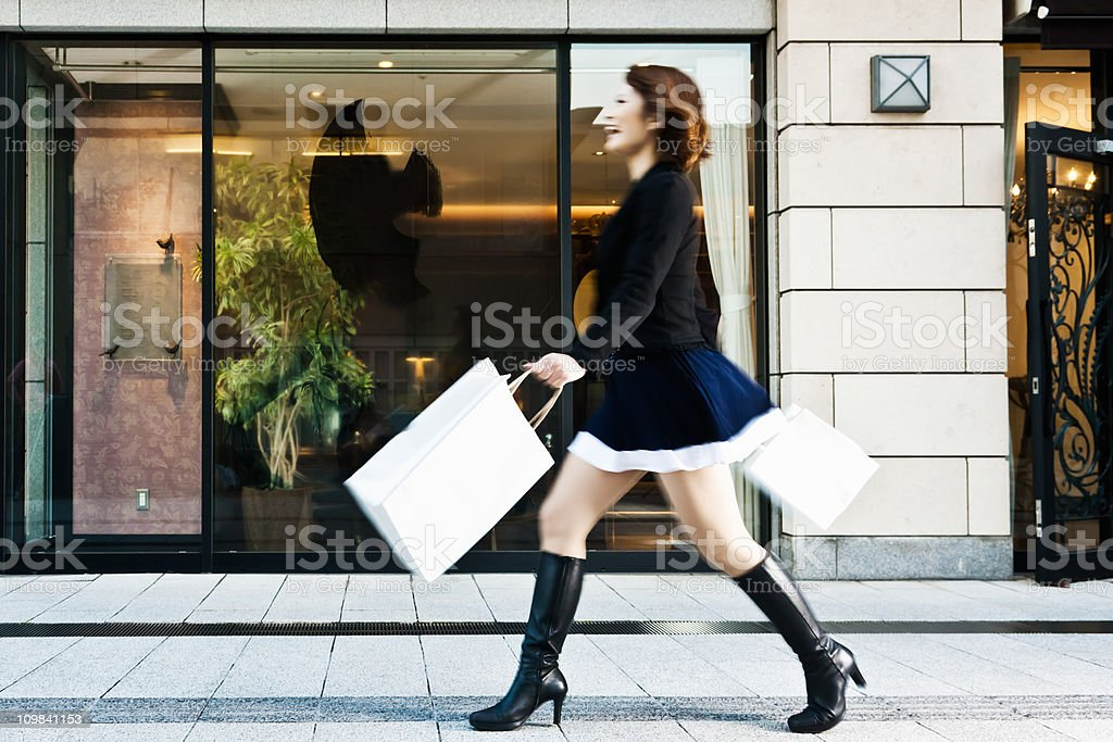 Spending Spree Happy Woman Shopping with Paper Bags stock photo