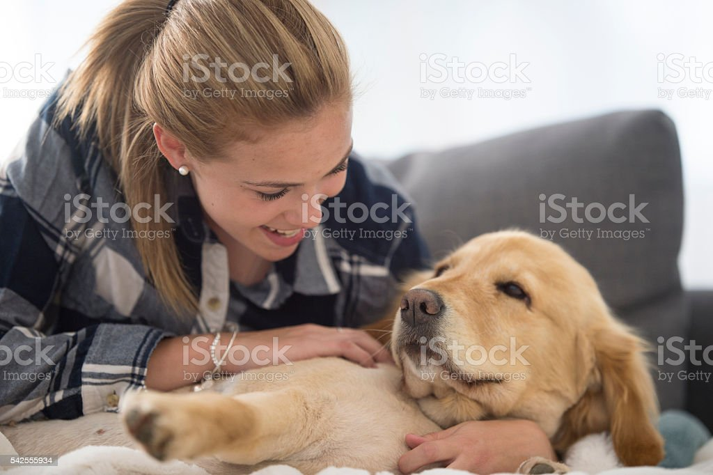 Spending Time with Her Puppy stock photo