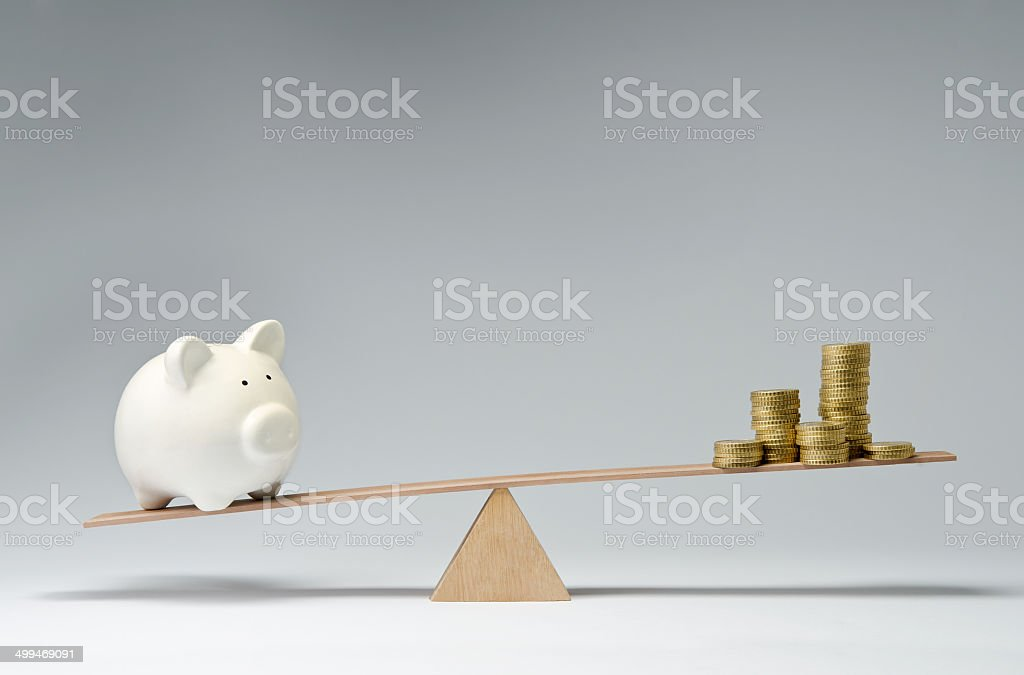 Spendings against savings stock photo