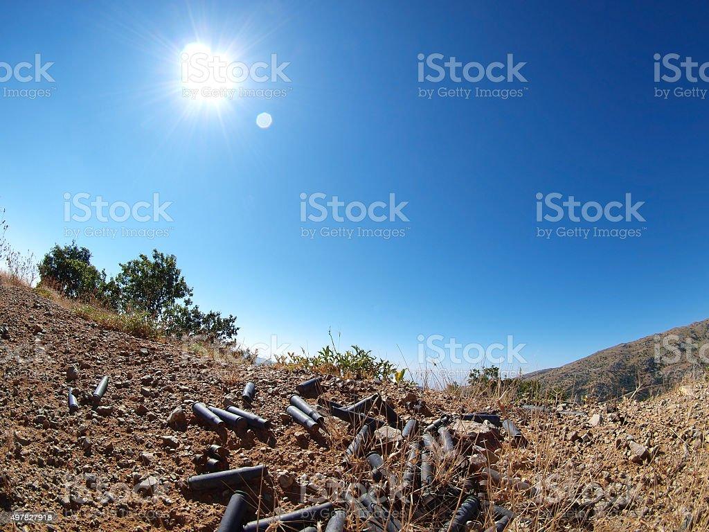 spent cartridges on the ground stock photo