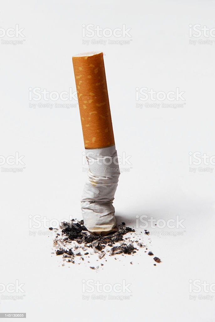 Spent cigarette butt and ash isolated on white background. stock photo