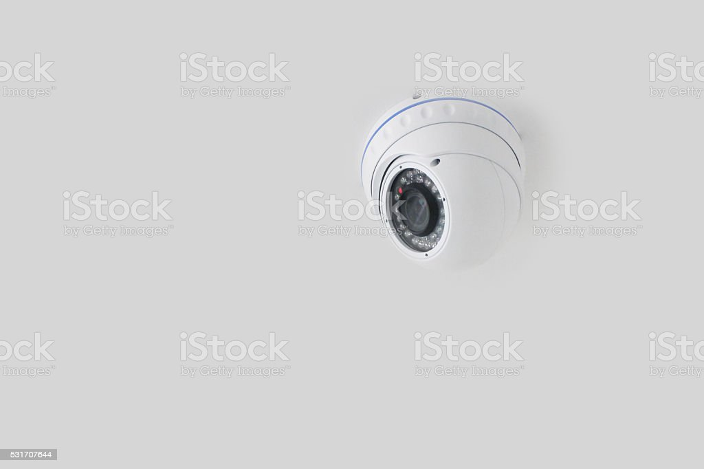Spherical ceiling security camera stock photo