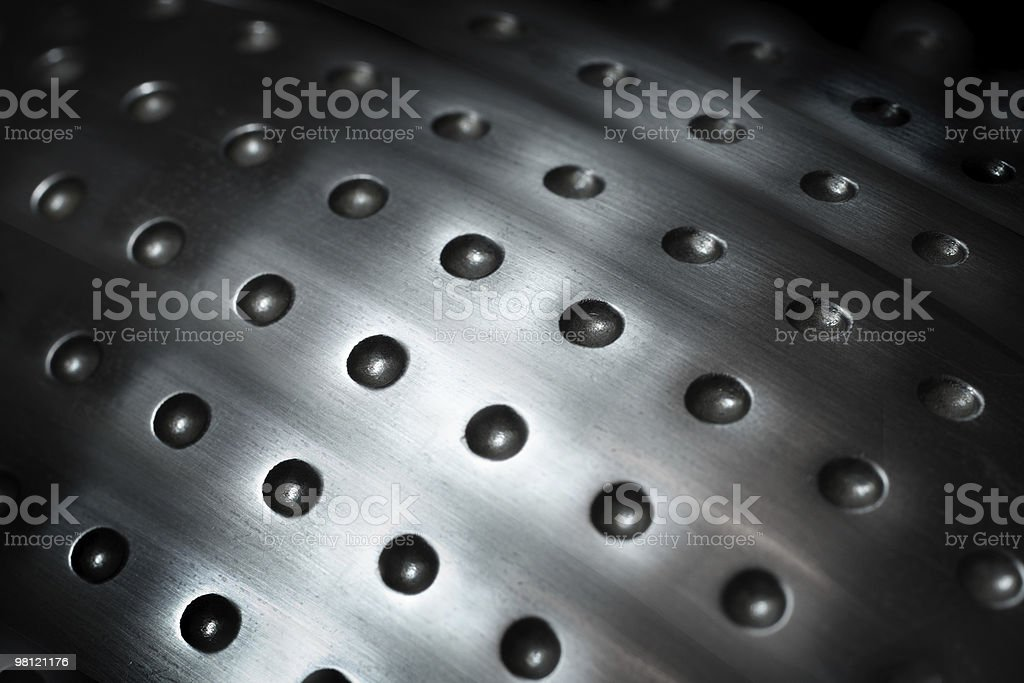 spherical metal surface background with holes royalty-free stock photo