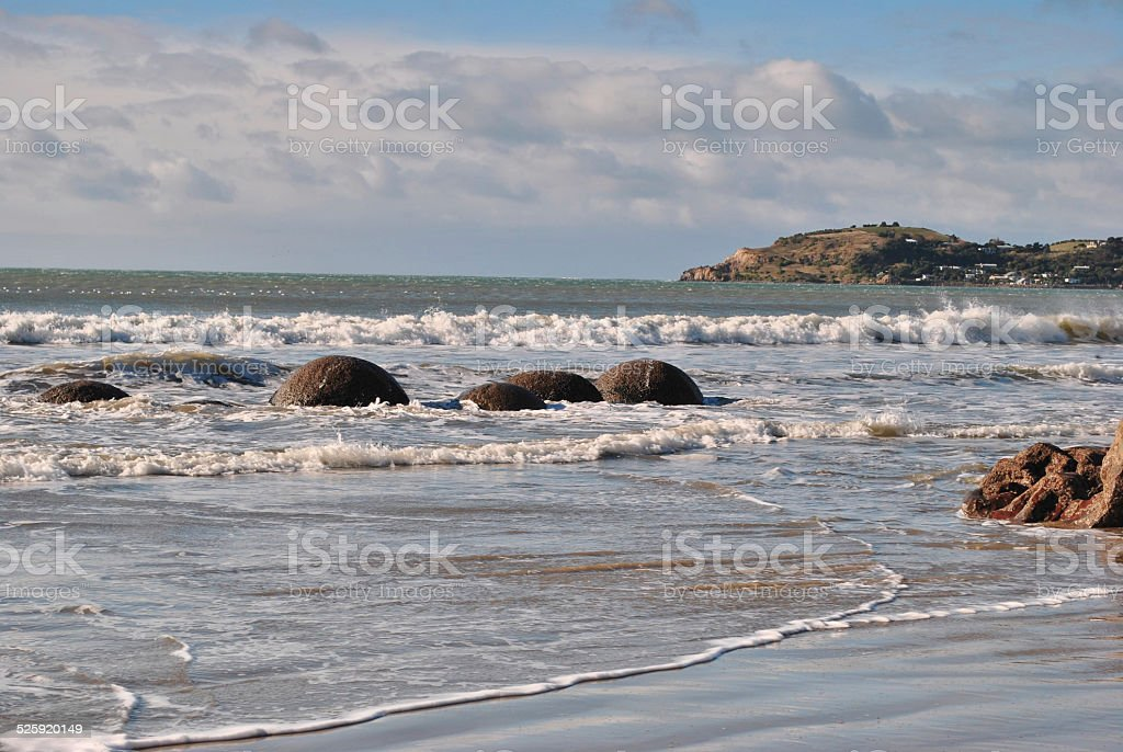 Spherical Moeraki boulder, New Zealand stock photo