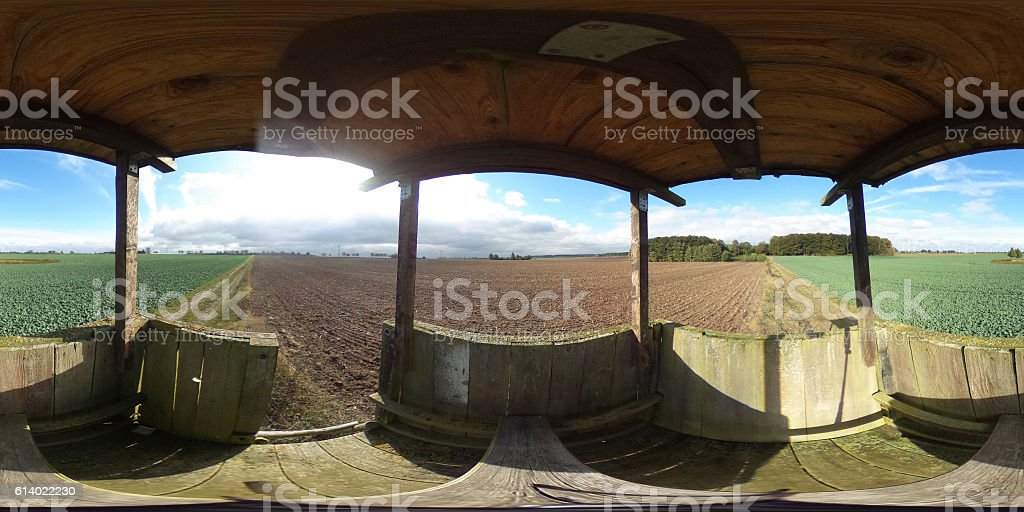 Spherical panorama from hunting pulpit on agricultural fields stock photo