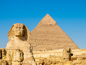 Sphinx and a pyramid in Giza in Cairo, Egypt