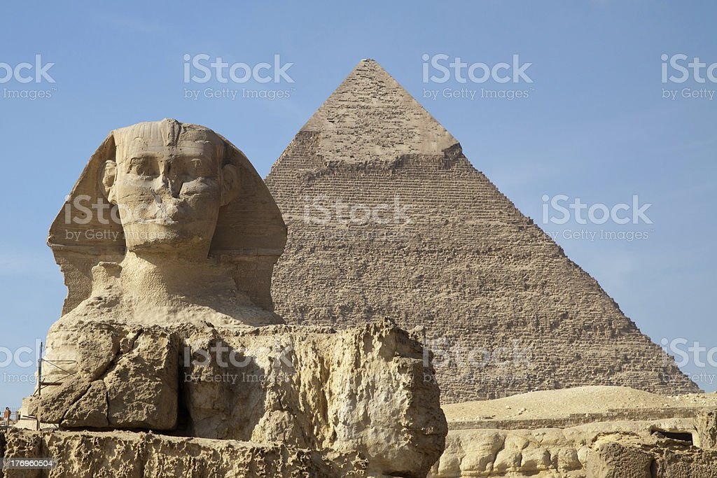 sphinx and pyramid at giza royalty-free stock photo