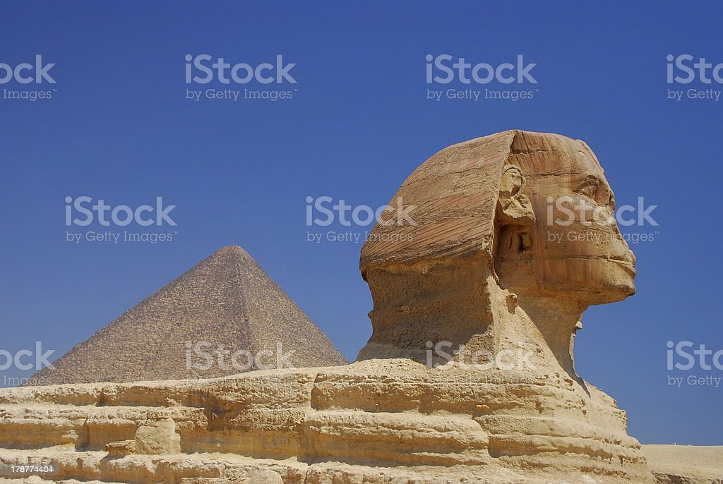 sphinx and pyramid in egypt royalty-free stock photo
