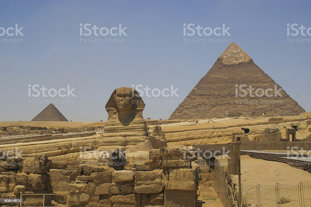 Sphinx and the pyramids royalty-free stock photo