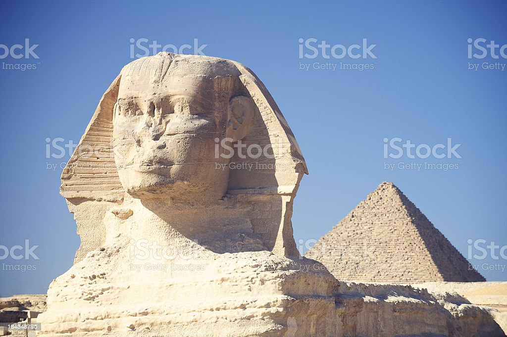 Sphinx with Great Pyramid Giza Egypt Blue Sky stock photo