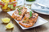 Spice grilled salmon with mango-avocado salsa on a white plate