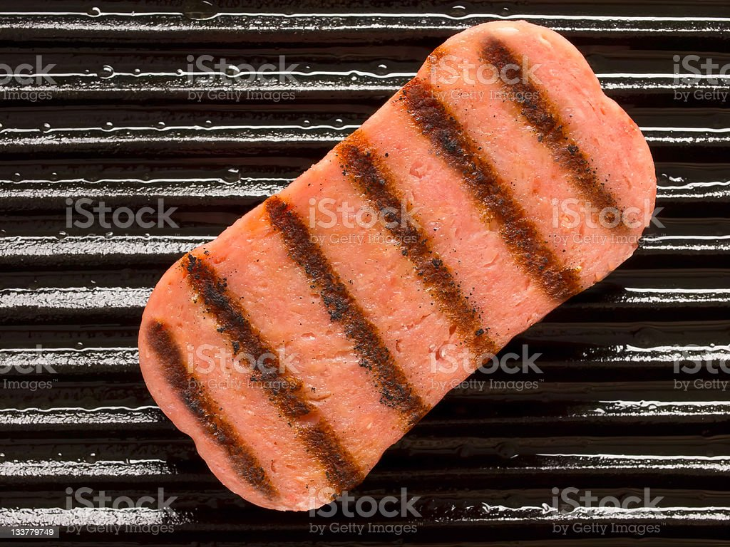 spice ham on a grill stock photo