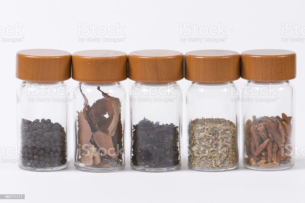 Spice jars in a row royalty-free stock photo