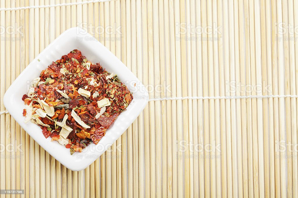 Spice mixture for soup in dish on mat stock photo