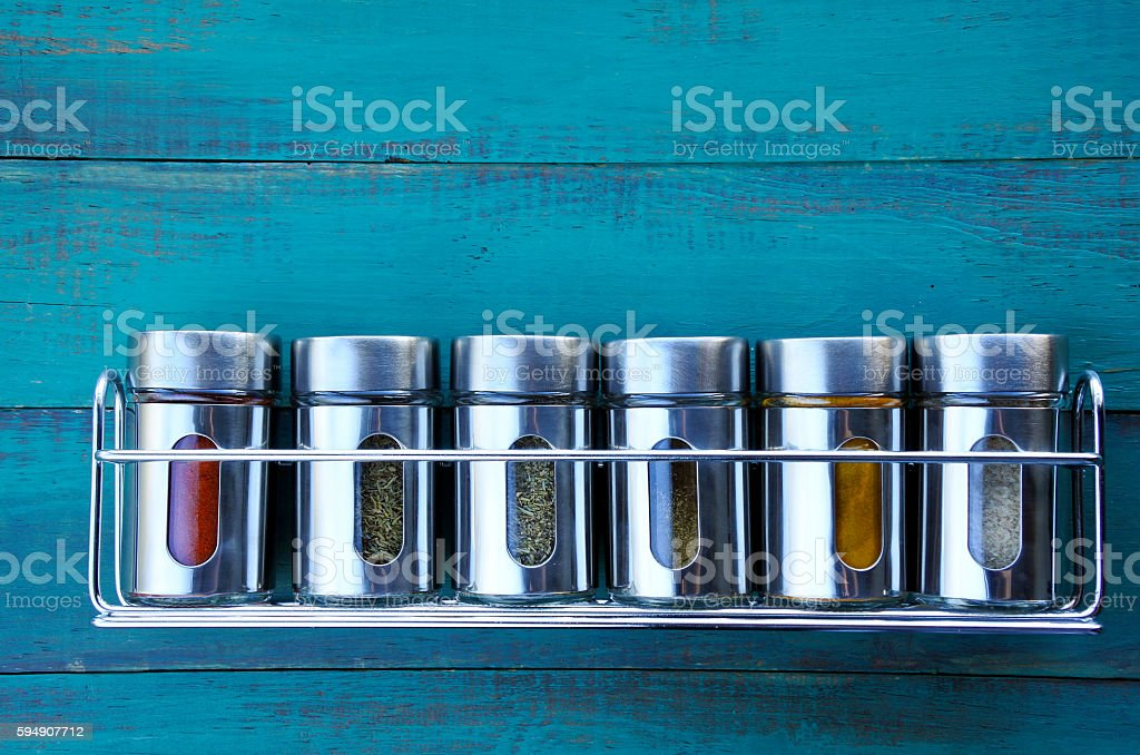 Spice rack on a wooden wall stock photo