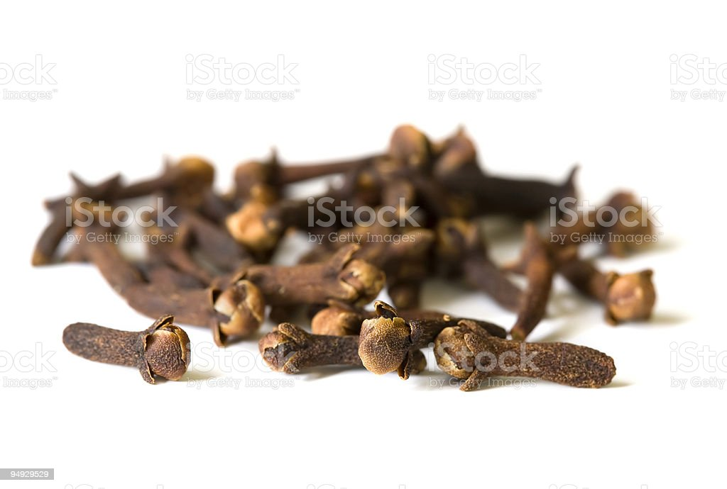spice series - dried cloves on white surface 2 stock photo