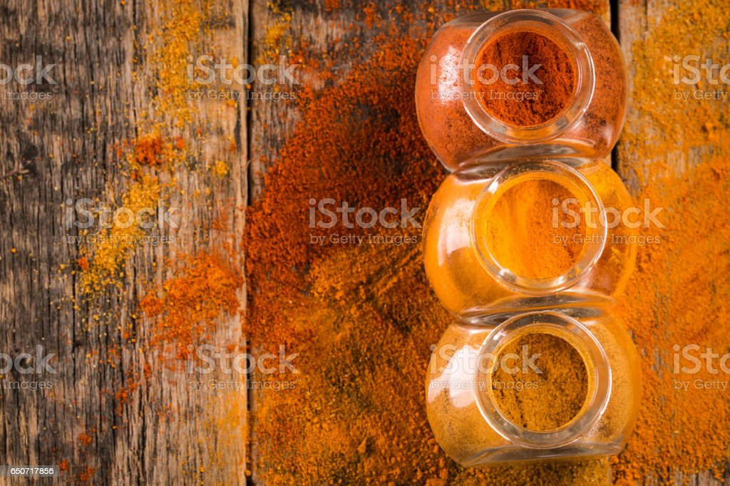 Spice. Various Spices over Wooden Background. paprika, turmeric, curry stock photo