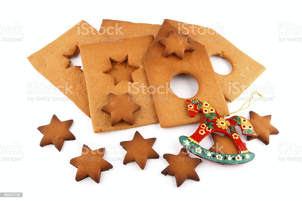 spice-cake house, sweet stars and red horse royalty-free stock photo