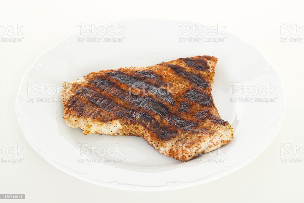 Spiced and grilled chicken filet royalty-free stock photo