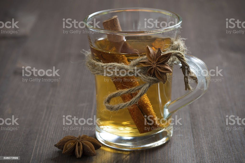 spiced apple cider on a wooden table royalty-free stock photo