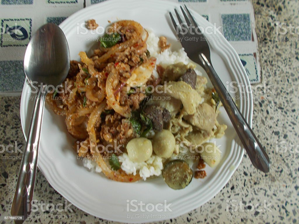 Spiced pork or and Green curry served with cooked rice. stock photo
