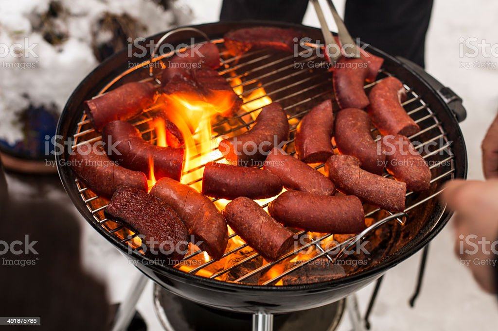 Spiced sausage on Barbecue stock photo