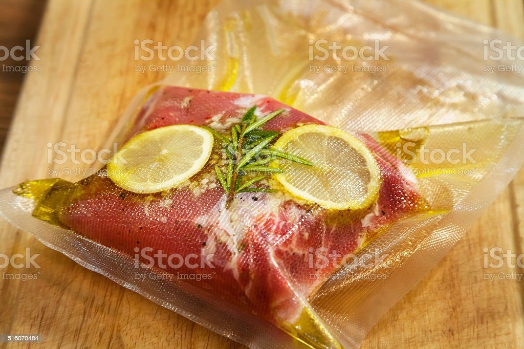 Spiced steak in vacuumed package. stock photo