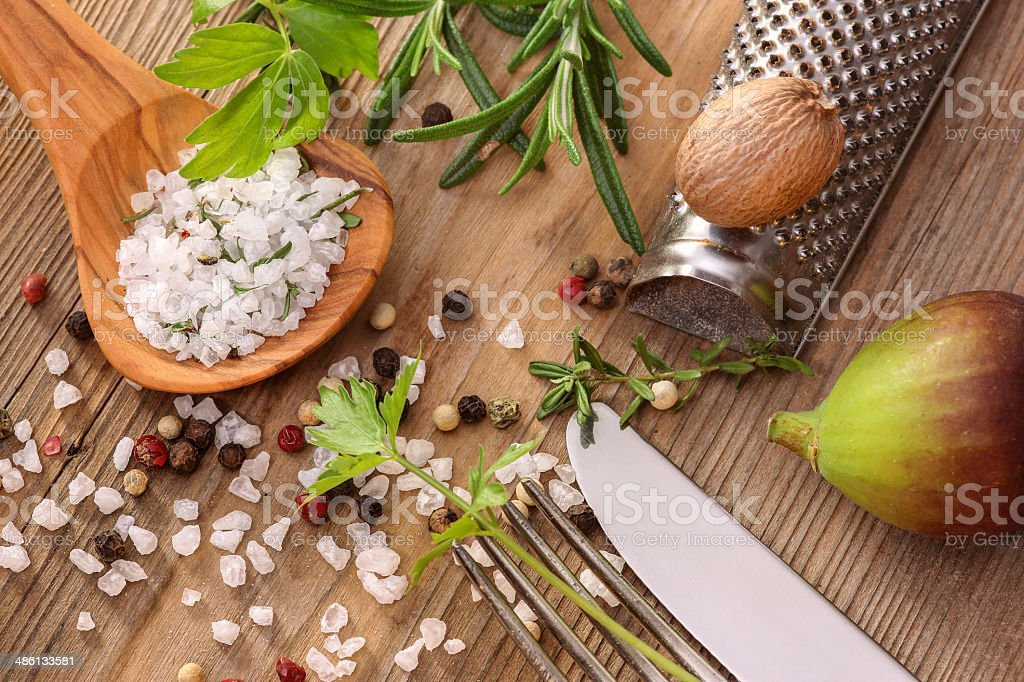 Spicery, herbs, fig and cutlery stock photo