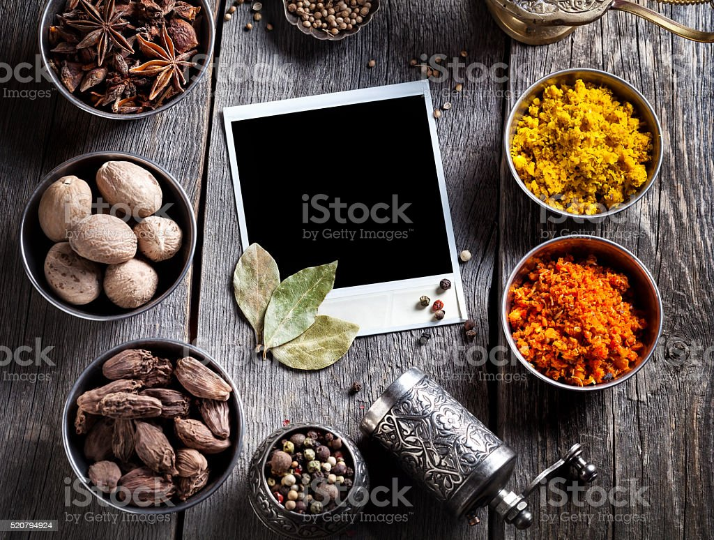 Spices and blank photo at the table stock photo