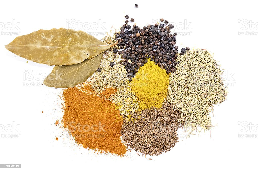 Spices and condiments from above on isolated white background royalty-free stock photo