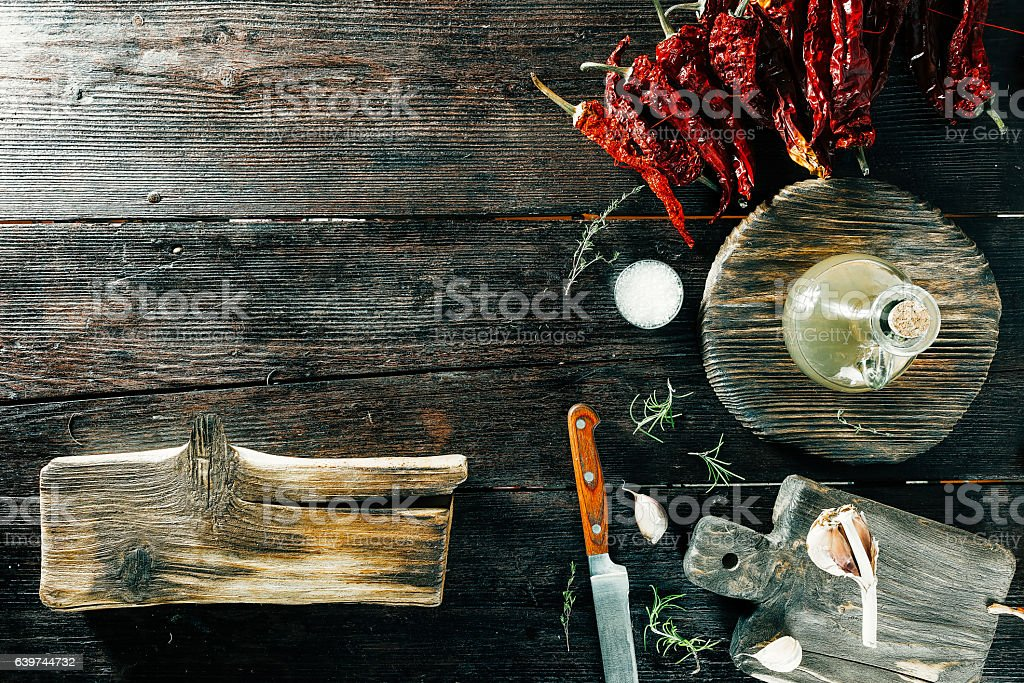 Spices and condiments on wooden boards stock photo