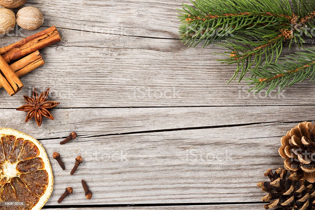spices and fir branch on wooden background stock photo