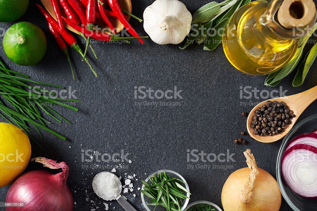Spices and Food Ingredients on Slate Background stock photo