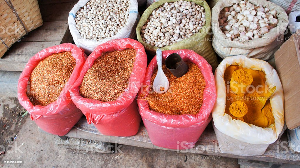 Spices and garlic in plastic bags on local burmese market stock photo
