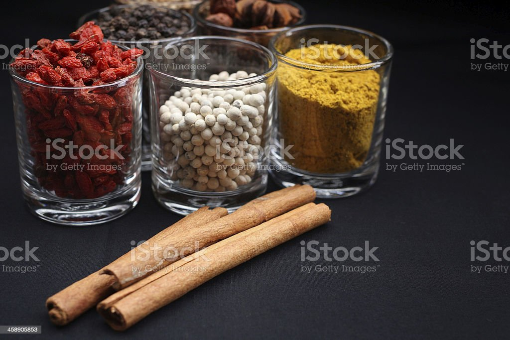 Spices and herbs in glass royalty-free stock photo