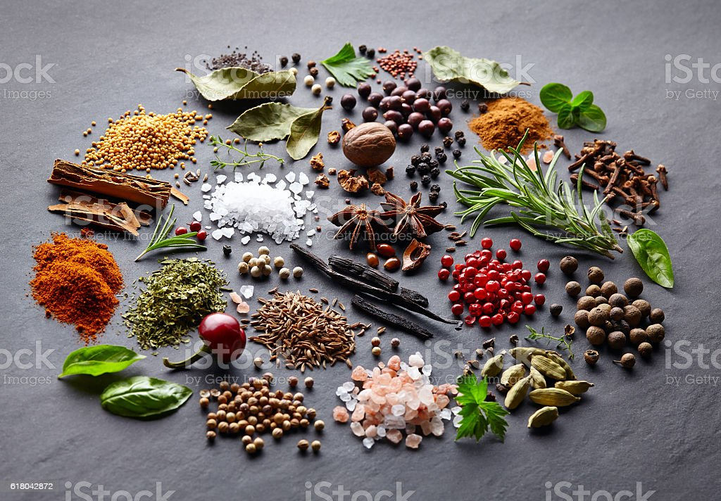 Spices and herbs on a black background stock photo