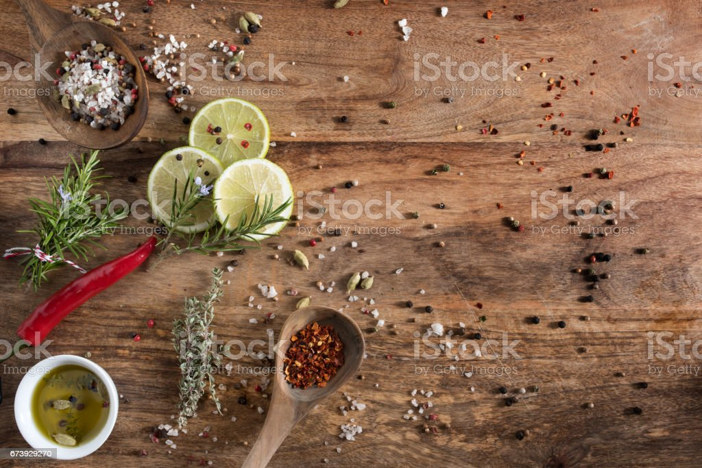 Spices and herbs on rustic wood stock photo