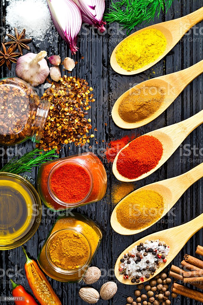 Spices and herbs shot directly above on black table stock photo