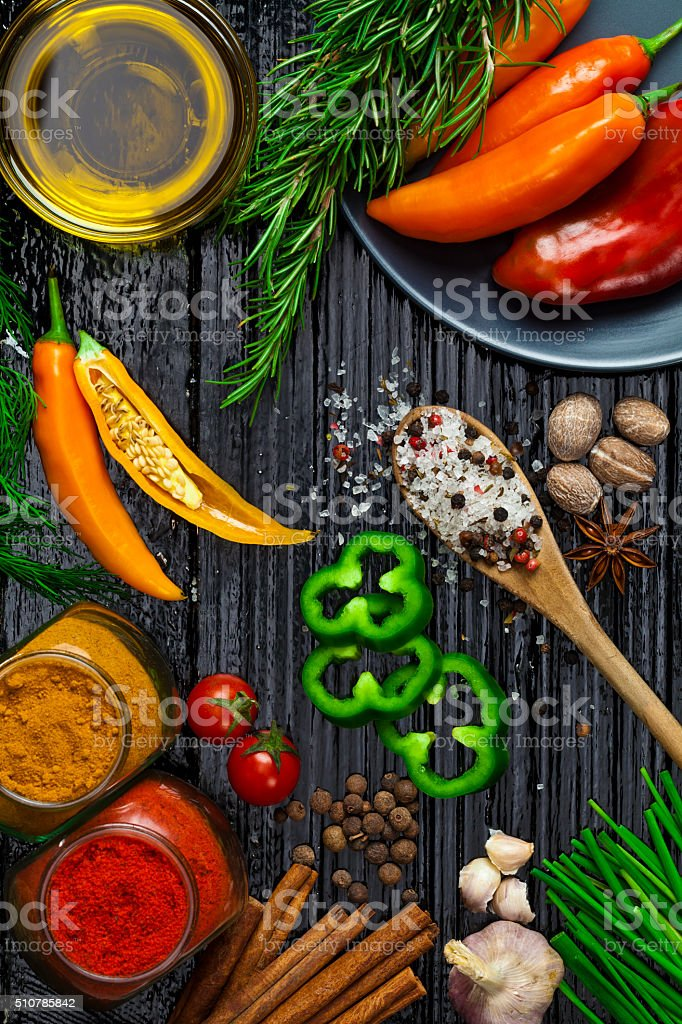 Spices and herbs shot directly above on dark table stock photo