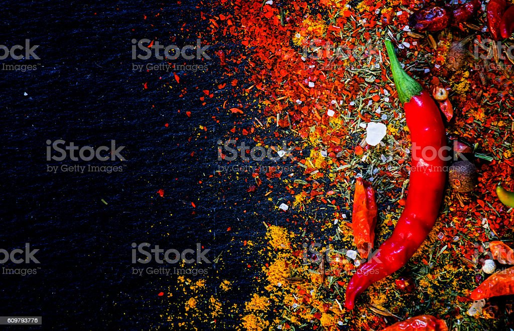 Spices and spicy chili peppers stock photo