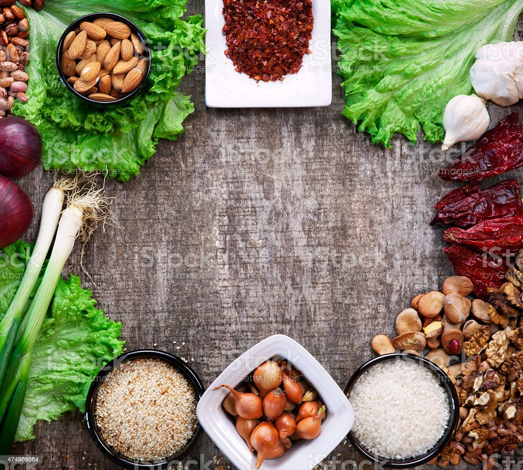 spices and vegetables on wooden board stock photo