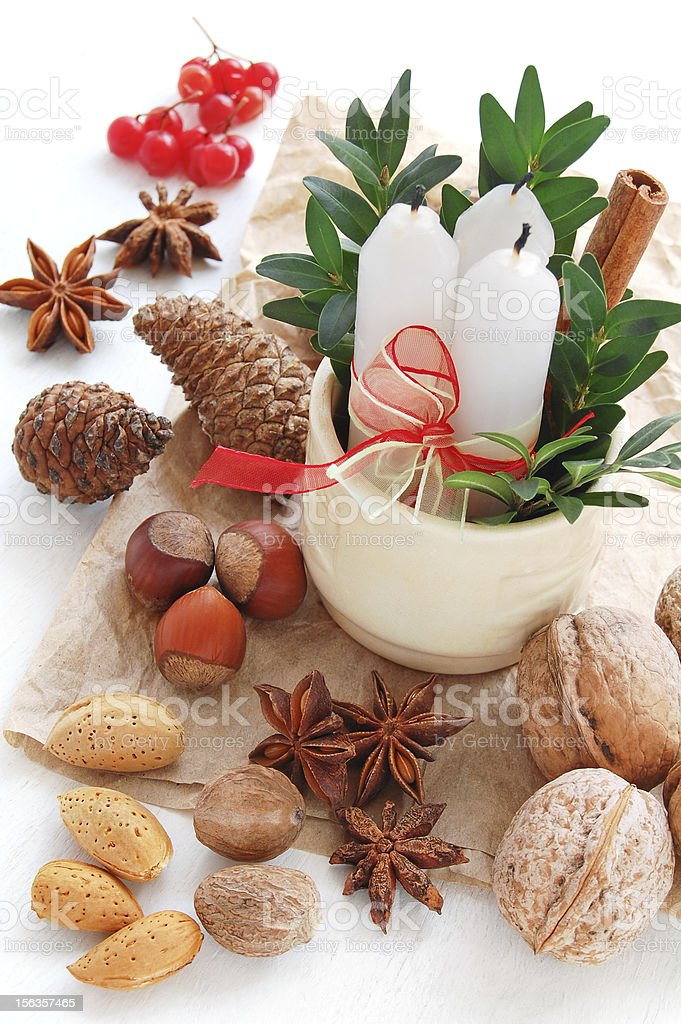 Spices, fir cones and candles for Christmas decoration royalty-free stock photo