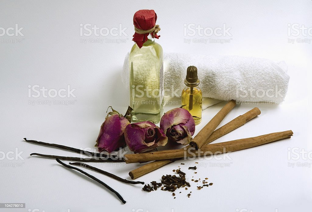 Spices, flowers and bottles with aromatherapy oil royalty-free stock photo