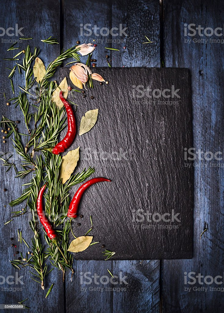 Spices food background with slate on blue wooden table stock photo
