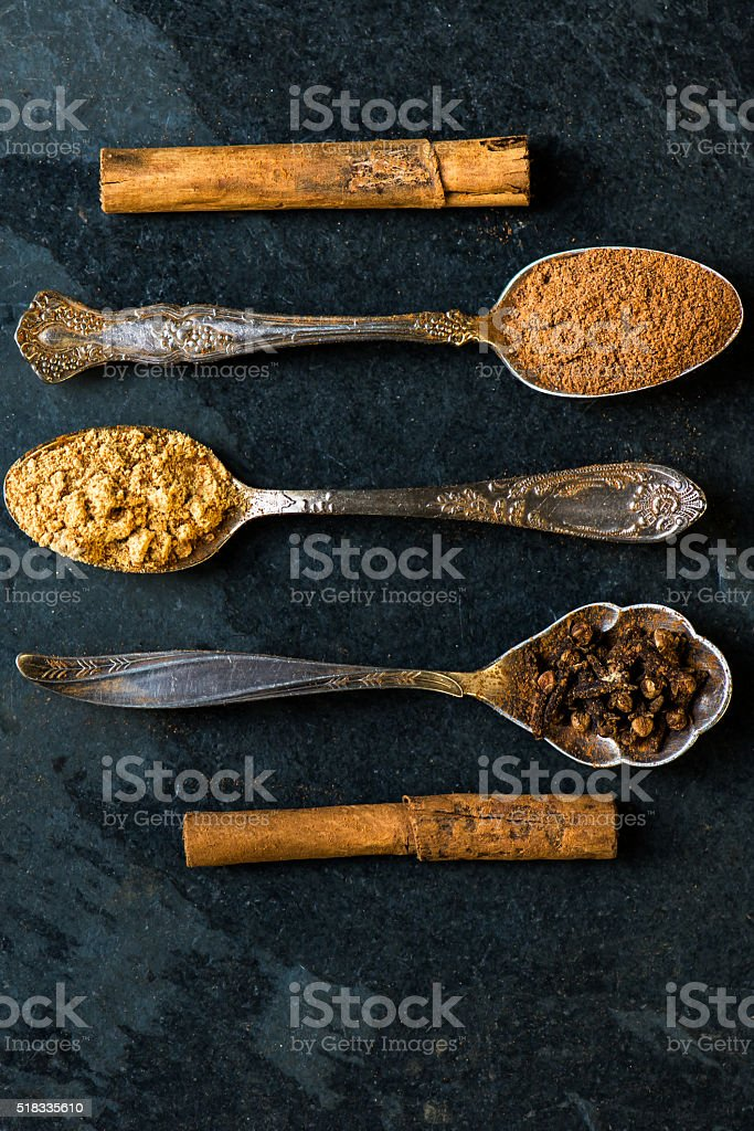 Spices for Christmas Gingerbread Cookies in Spoons stock photo