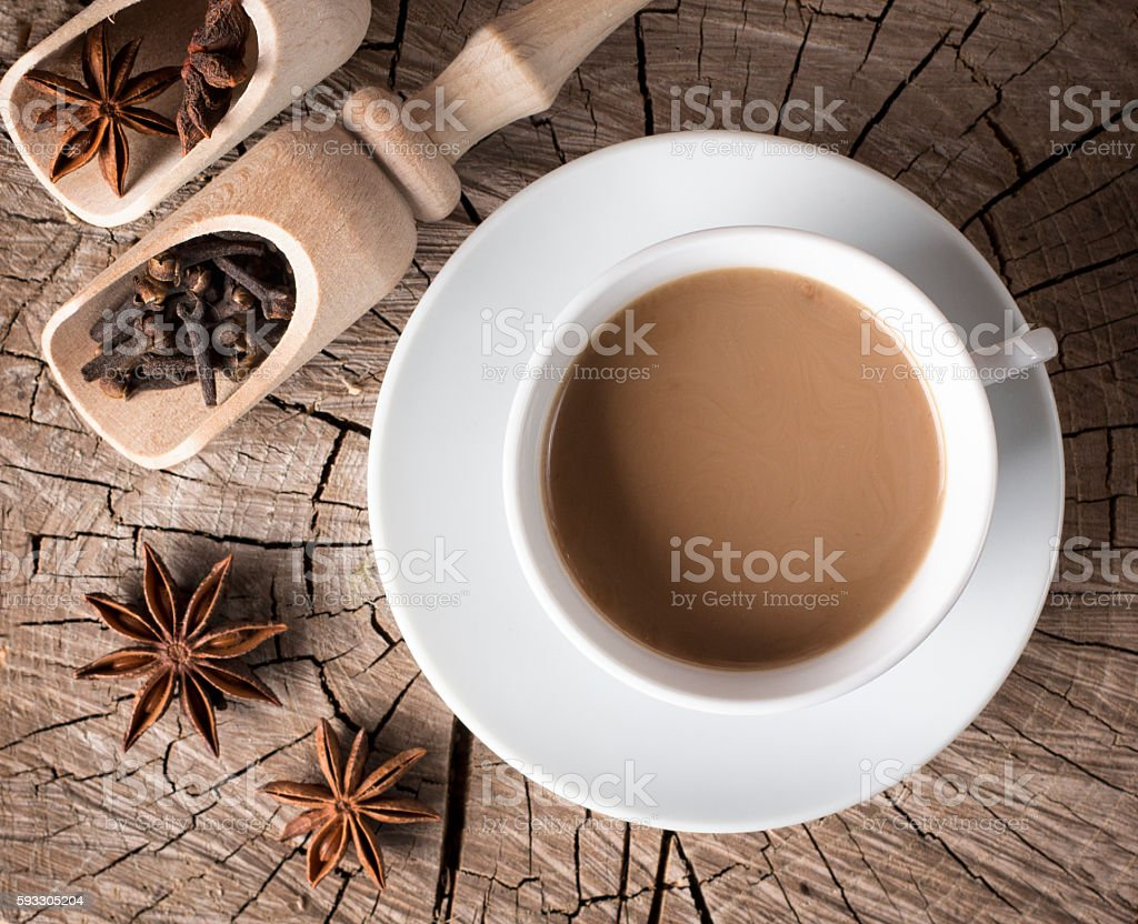 spices for hot drinks and a cup of hot coffee stock photo